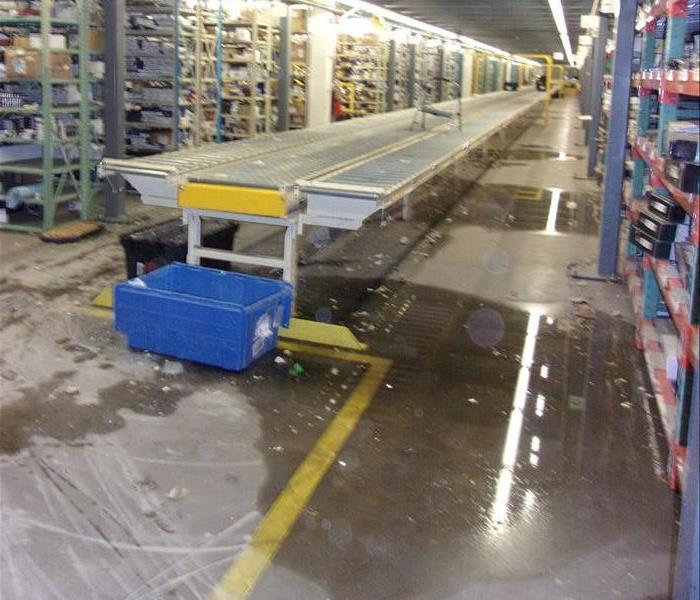 Water on floor in large warehouse.