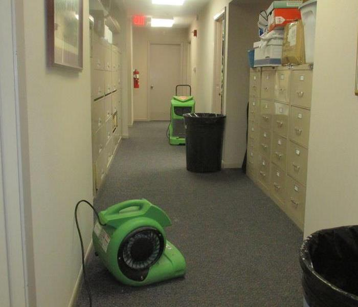 Drying equipment set up in a hallway.