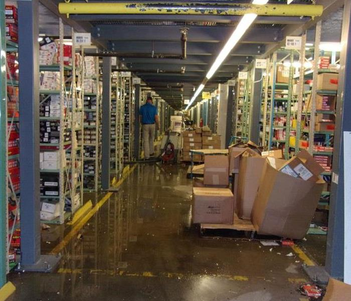 Standing water in commercial ware house.